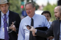 Sen. Michael Crapo, R-Idaho is pursued by reporters as he arrives for a meeting with Republican presidential candidate Donald Trump and the Senate Republican Conference, Thursday, July 7, 2016, at the National Republican Senatorial Committee headquarters in Washington. (AP Photo/Alex Brandon)
