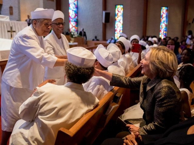 Democratic presidential candidate Hillary Clinton is greeted by members of the audience after speaking at the Little Rock AME Zion Church in Charlotte, N.C., Sunday, Oct. 2, 2016.
