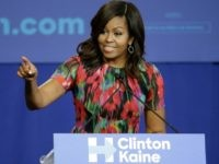 First lady Michelle Obama speaks during a campaign rally for Democratic presidential candidate Hillary Clinton in Charlotte, N.C., Tuesday, Oct. 4, 2016. (AP Photo/Chuck Burton)