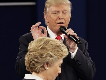 Democratic presidential nominee Hillary Clinton walks past Republican presidential nominee Donald Trump during the second presidential debate at Washington University in St. Louis, Sunday, Oct. 9, 2016. (AP Photo/John Locher)