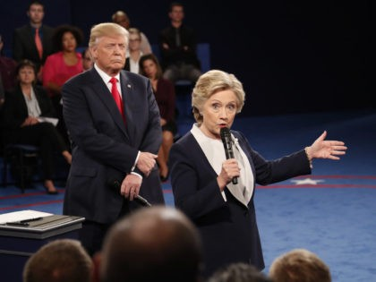 Democratic presidential nominee Hillary Clinton speaks as Republican presidential nominee Donald Trump listens during the second presidential debate at Washington University in St. Louis, Sunday, Oct. 9, 2016. (Rick T. Wilking/Pool via AP)