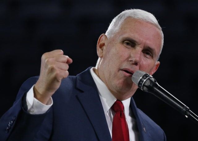 Republican Vice Presidential candidate, Indiana Gov. Mike Pence, gestures as he speaks at Liberty University in Lynchburg, Va., Wednesday, Oct. 12, 2016. (AP Photo/Steve Helber)