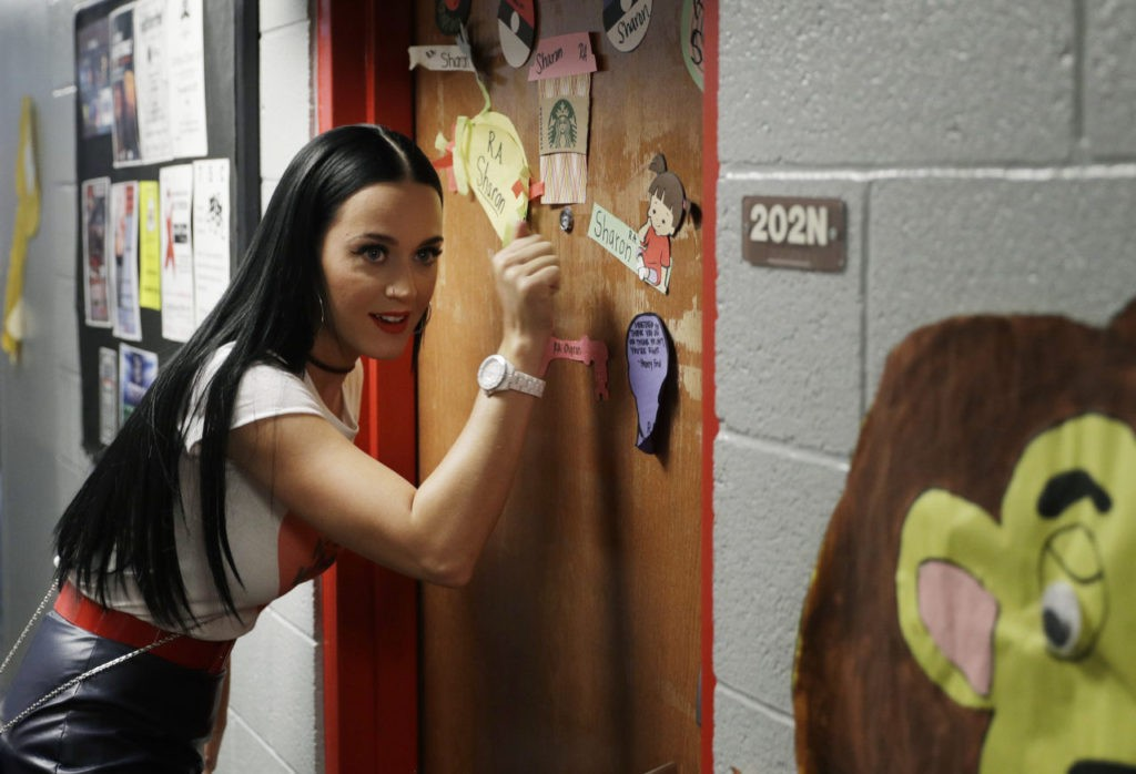 Singer Katy Perry canvasses for Democratic presidential nominee Hillary Clinton in a dorm at the University of Nevada, Las Vegas, Saturday, Oct. 22, 2016, in Las Vegas. (AP Photo/John Locher)