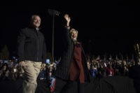 Democratic presidential candidate Hillary Clinton and vice presidential candidate Sen. Tim Kaine, D-Va. arrive at a campaign event at Dunning-Cohen Champions Field, Saturday, Oct. 22, 2016, in Philadelphia. (AP Photo/Mary Altaffer)