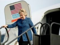 Hillary Clinton Smiles And Waves After Reporters Ask About Reopened Server Investigation