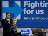 emocratic presidential candidate Hillary Clinton joined by Rep. Tim Ryan, D-Ohio., speaks during a campaign event at M-7 Technologies in Youngstown, Ohio, Saturday, March 12, 2016. (