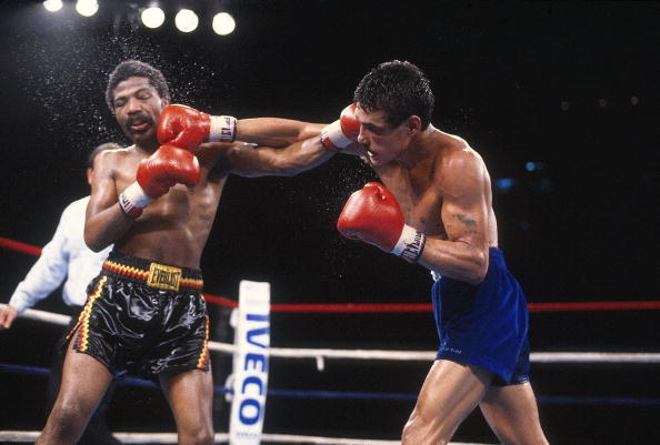 Boxing: WBA World Light Welterweight Title: Alexis Arguello (R) in action, throwing punch vs Aaron Pryor during match at Orange Bowl Stadium. Miami, FL 11/12/1982 CREDIT: Manny Millan (Photo by Manny Millan /Sports Illustrated/Getty Images) (Set Number: X27658 TK1 R10 F1 )