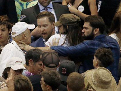 Anti-Trump protester chokes Trump fan (Ross D. Franklin / Associated Press)