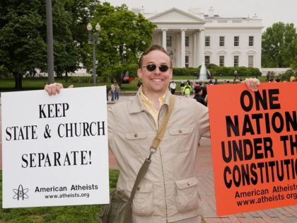 Jeff Wismer demonstrates his Atheist viewpoints in front of the White House with several other demonstraters from the American Atheists and Beltway Atheists May 1, 2008 in front of the White House in Washington. AFP Photo/Paul J. Richards (Photo credit should read PAUL J. RICHARDS/AFP/Getty Images)