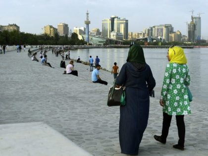 Two woman take a walk at the shore of the Caspian Sea in Baku on June 21, 2015, where the 2015 European Games are taking place. AFP PHOTO / TOBIAS SCHWARZ (Photo credit should read TOBIAS SCHWARZ/AFP/Getty Images)