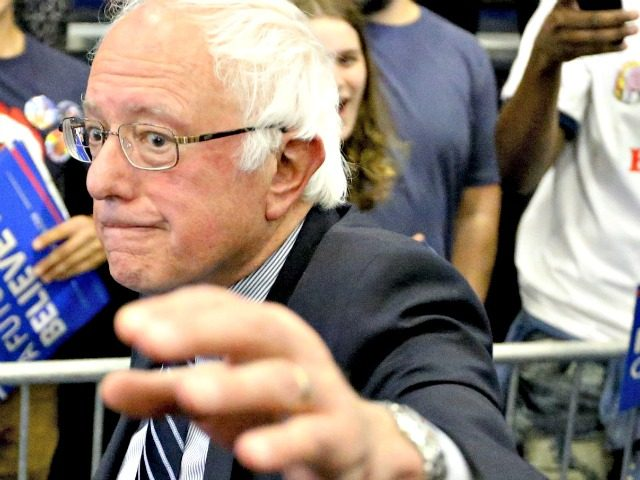 Democratic presidential candidate Sen. Bernie Sanders, I-Vt., waves as he leaves a campaign rally at Fitzgerald Fieldhouse on the University of Pittsburgh campus, Monday, April 25, 2016, in Pittsburgh. (AP Photo/Keith Srakocic)