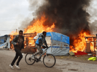 Calais Jungle Demolition Pictures: Chaos as Fires Blaze, Migrants May Return