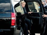 Clinton Peaks Out of Limo Andrew HarnickAP
