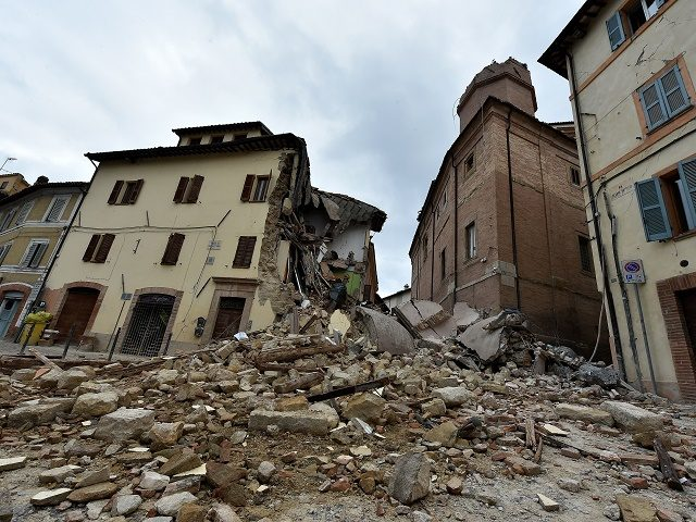 """A photo taken on October 28, 2016 shows the collapsed bell tower of the Santa Maria in Via church in the """"red zone"""", an area cordoned off for safety reasons, in Camerino, where 80 per cent of the houses have been left uninhabitable after two earthquakes hit the region. Italy …"""