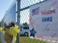 Yellow ribbons and a welcome home sign were tied to a fence outside an Iowa National Guard facility in Davenport, Iowa ahead of a homecoming ceremony for 75 veterans returning from Iraq after a year-long deployment on November 23, 2011.