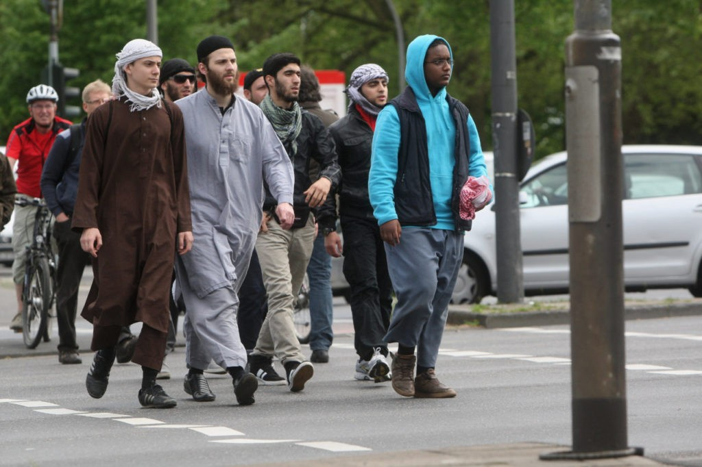 COLOGNE, GERMANY - MAY 08: Salafist supporters, who had come to counter-protest against a demonstration by right-wing pro NRW supporters outside the new Central Mosque (Zentralmoschee) in Ehrenfeld district, clash with police on May 8, 2012 in Cologne, Germany. Pro NRW, a right-wing political party and movement opposed to Islam and the construction of new mosques in the German state of North Rhine-Westphalia, has been protesting outside mosques over the past two weeks and in some cases showing caricature drawings related to Islam in an attempt to gain support ahead of state elections scheduled for May 13. Salafis also clashed violently with police at a similar event recently in Bonn. (Photo by Mathis Wienand/Getty Images)