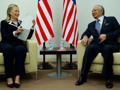 Malaysian Prime Minister Najib Razak (R) speaks with US Secretary of State Hillary Clinton (L) during a bilateral meeting for the Asian Pacific Economic Cooperation (APEC) Summit in Vladivostok on September 9, 2012. AFP PHOTO/POOL/Jim WATSON (Photo credit should read JIM WATSON/AFP/GettyImages)