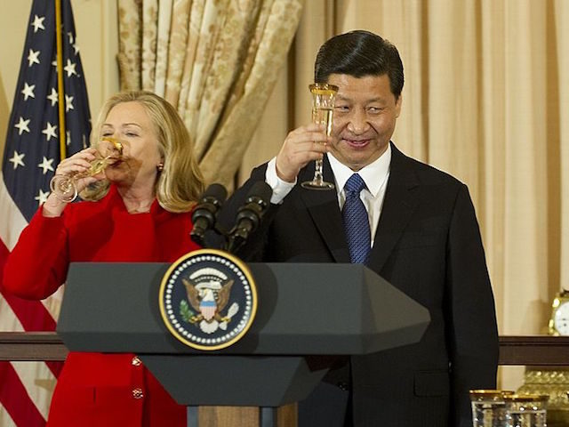 Chinese Vice President Xi Jinping (C) proposes a toast with Vice President Joe Biden (R) and Secretary of State Hillary Clinton (L) during a a lunch in honor of Chinese VP at the State Department in Washington, DC, February 14, 2012. AFP PHOTO/Jim WATSON (Photo credit should read JIM WATSON/AFP/Getty …