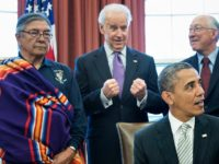 L-R: Samuel Gomez (L), War Chief of the Taos Pueblo, US Vice President Joseph R. Biden, US Secretary of the Interior Kenneth L. Salazar and Asha Lela, Chair of the Islanders for the San Juan Islands National Monument, look on as US President Barack Obama speaks about signing the First …