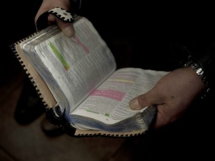 An evangelist inmate reads the Bible with their fellow prisoners in the Colina prison in Santiago, Chile, August 22, 2014.