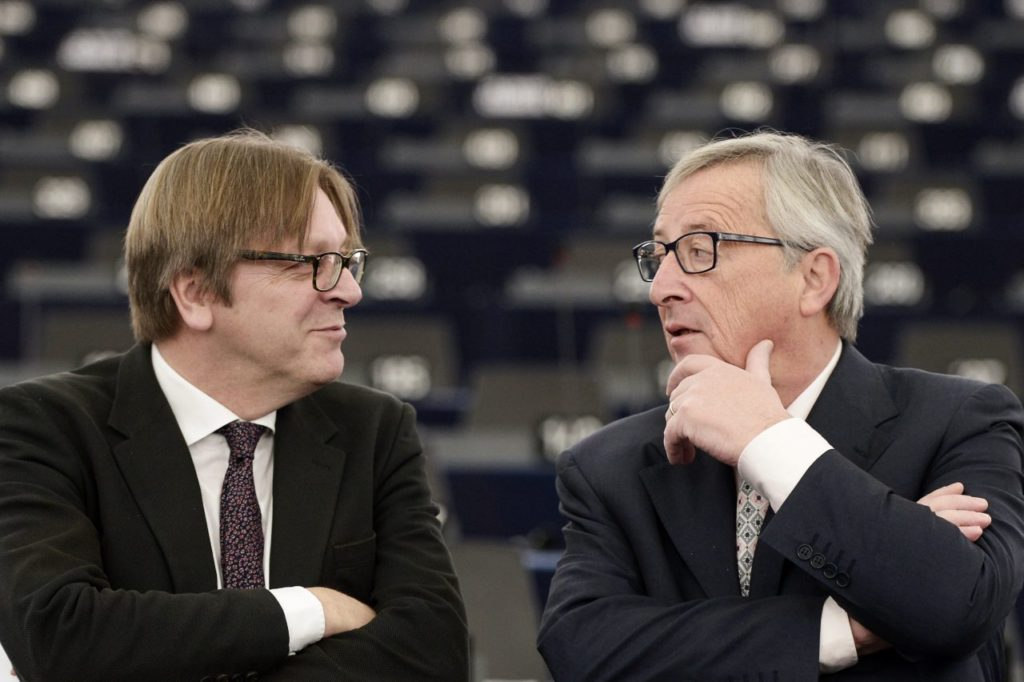 EU Commission chief Jean-Claude Juncker (R) speaks with Alliance of liberals and Democrats for Europe (ALDE) group leader and Belgian member of the European Parliament Guy Verhofstadt prior to a debate on the outgoing Italian Presidency of the Council of the European Union, at the European Parliament on January 13, 2015 in Strasbourg, eastern France. AFP PHOTO / FREDERICK FLORIN (Photo credit should read FREDERICK FLORIN/AFP/Getty Images)