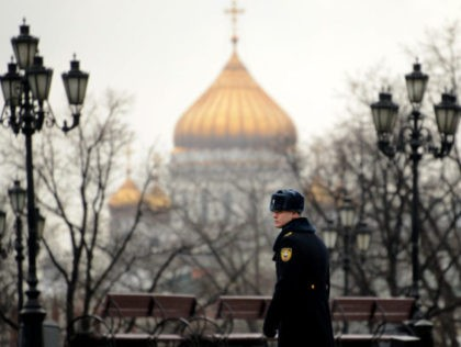 A soldier of the Presidential Regiment walks in central Moscow, on January 10, 2014, with the giant Christ the Saviour Cathedral dominating the landscape (back). AFP PHOTO / KIRILL KUDRYAVTSEV (Photo credit should read KIRILL KUDRYAVTSEV/AFP/Getty Images)