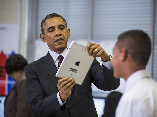 ADELPHI, MD - FEBRUARY 04: (AFP OUT) U.S. President Barack Obama (L) uses an Apple iPad to record a seventh grader as he tours a classroom that uses technology to enhance students' learning experience, prior to delivering remarks on the ConnectED Initiative at Buck Lodge Middle School February 4, 2014 …