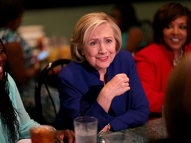 COLUMBIA, SC - MAY 27: Democratic Presidential Candidate Hillary Clinton sits in on a round table discussion as she visits the Kikis Chicken and Waffles restaurant on May 27, 2015 in Columbia, South Carolina. Hillary Clinton continues to campaign throughout the country for the Democratic nomination. (Photo by Joe Raedle/Getty …