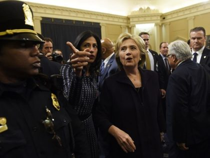 Former Secretary of State and Democratic Presidential hopeful Hillary Clinton (C) walks next to Huma Abedin (2L) after Clinton testified before the House Select Committee on Benghazi on Capitol Hill in Washington, DC, October 22, 2015. Clinton took the stand to defend her role in responding to deadly attacks on …