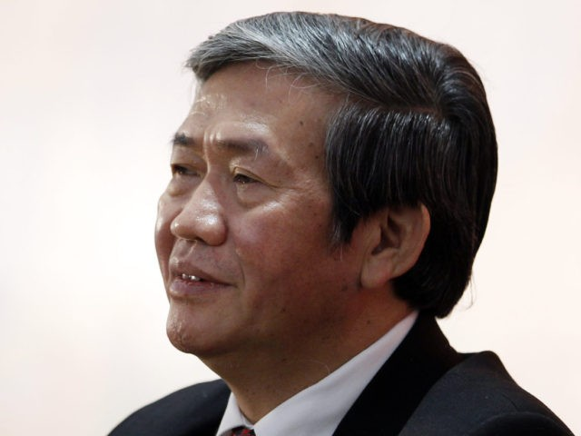 Dinh The Huynh, head of the Central Propaganda Department of Vietnam, smiles during a press conference after the closing ceremony on the final day of the 12th National Congress of Vietnam's Communist Party in Hanoi on January 28, 2016. Vietnam's top communist leader Nguyen Phu Trong was re-elected on January …