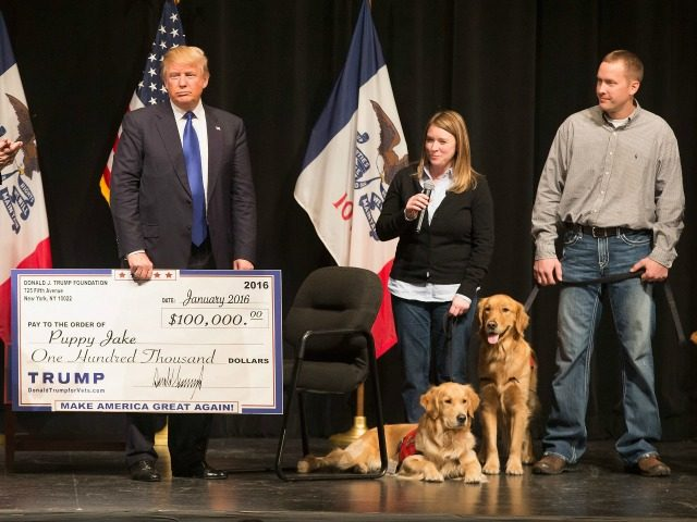 Republican presidential candidate Donald Trump presented a check to the Puppy Jake on January 30, 2016 in Davenport, Iowa.