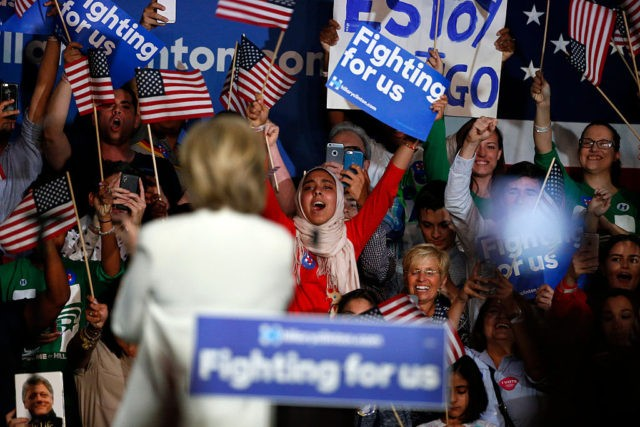Democratic presidential candidate Hillary Clinton waves to supporters during a campaign rally on Super Tuesday in Miami on March 1, 2016. Democrat Hillary Clinton scored a string of early wins on Super Tuesday, US networks projected, putting her closer to the presidential nomination. / AFP / RHONA WISE (Photo credit …