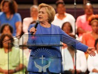 LOUISVILLE, KY - MAY 15: Democratic presidential candidate Hillary Clinton (L) addresses the crowd during a campaign stop at Canaan Missionary Church May 15, 2016 in Louisville, Kentucky. Clinton is preparing for Kentucky's May 17th primary. (Photo by John Sommers II/Getty Images)
