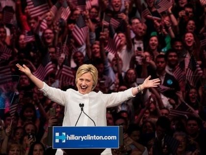 NEW YORK, NY - JUNE 7: Democratic presidential candidate Hillary Clinton arrives onstage during a primary night rally at the Duggal Greenhouse in the Brooklyn Navy Yard, June 7, 2016 in the Brooklyn borough of New York City. Clinton has secured enough delegates and commitments from superdelegates to become the …