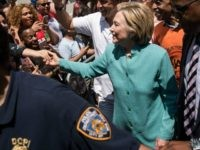 Democratic presidential candidate Hillary Clinton, flanked by New York Governor Andrew Cuomo and Rev. Al Sharpton, attends the New York City Gay Pride Parade, June 26, 2016 in New York City. Over 30,000 people marched in the 46th annual parade. (