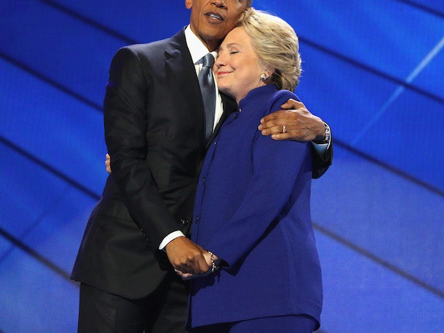 PHILADELPHIA, PA - JULY 27: US President Barack Obama and Democratic presidential candidate Hillary Clinton embrace on the third day of the Democratic National Convention at the Wells Fargo Center, July 27, 2016 in Philadelphia, Pennsylvania. Democratic presidential candidate Hillary Clinton received the number of votes needed to secure the …