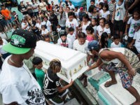 MANILA, PHILIPPINES - AUGUST 21: Relatives mourn as the coffin of an alleged thief and drug peddler and victim of an extrajudicial killing is laid to rest on August 21, 2016 in Manila, Philippines. The death toll from the Philippines' war on drugs initiated by President Rodrigo Duterte has spiked …