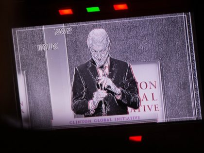 Former President and Founding Chairman of the Clinton Global Initiative Bill Clinton is seen on a monitor as he speaks during the Plenary Session II: Reconciliation and a Shared Society, at the Clinton Global Initiative September 20, 2016 in New York. / AFP / Bryan R. Smith (Photo credit should …