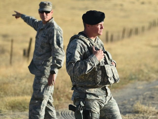 Members of the military look on near site where an Air Force U-2 crashed in Sutter, California on September 20, 2016.
