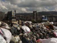 Garbage piles up at a temporary dump on a highway in the town of Jdeideh, north of the Lebanese capital Beirut, on September 22, 2016. Lebanon is entering a new garbage crisis after the government reached a temporary solution to the eight-month-long garbage crisis in March 2016. / AFP / …