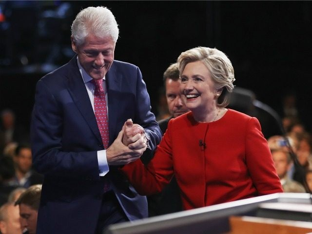 Democratic presidential nominee Hillary Clinton (R) shakes hands with husband and former U.S. President Bill Clinton (L) after the Presidential Debate with Republican presidential nominee Donald Trump at Hofstra University on September 26, 2016 in Hempstead, New York.