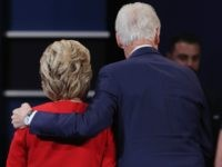 Hillary Clinton (L) hugs husband and former U.S. President Bill Clinton (R) September 26, 2016 in Hempstead, New York.