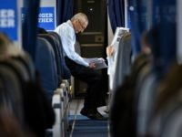 ohn Podesta, Clinton Campaign Chairman, reads over notes on board Democratic presidential nominee Hillary Clinton's plane at Westchester County Airport September 27, 2016 in White Plains, New York, before traveling with Clinton to Raleigh, North Carolina. / AFP / Brendan Smialowski (Photo credit should read
