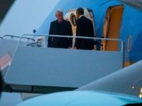 President Barack Obama (R) and former President Bill Clinton (L) walk off Air Force One at Andrews Air Force Base on September 30, 2016 in Joint Base Andrews, Maryland.