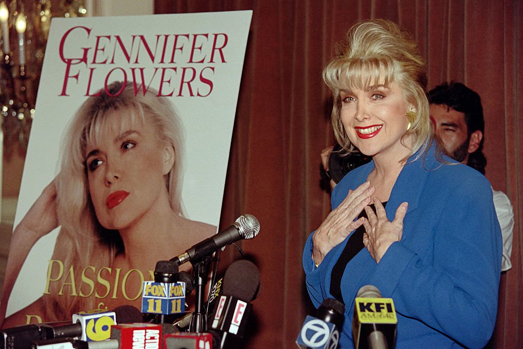 "Gennifer Flowers, who claims to have carried on a 12-year relationship with US President Bill CLinton, reacts to a question of whether she still loves Bill Clinton during a press conference on April 24, 1995, where she promoted her autobioraphy ""Passion and Betrayal"". The book chronicles her life and her relationship with Clinton. / AFP / Mike NELSON (Photo credit should read MIKE NELSON/AFP/Getty Images)"