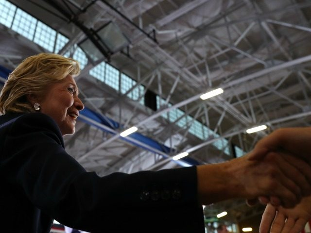 Democratic presidential nominee former Secreatry of State Hillary Clinton greets supporters during a campaign rally at Goodyear Hall and Theatre on October 3, 2016 in Akron, Ohio. Clinton is campaigning in Ohio ahead of the November 8th election. (Photo by )