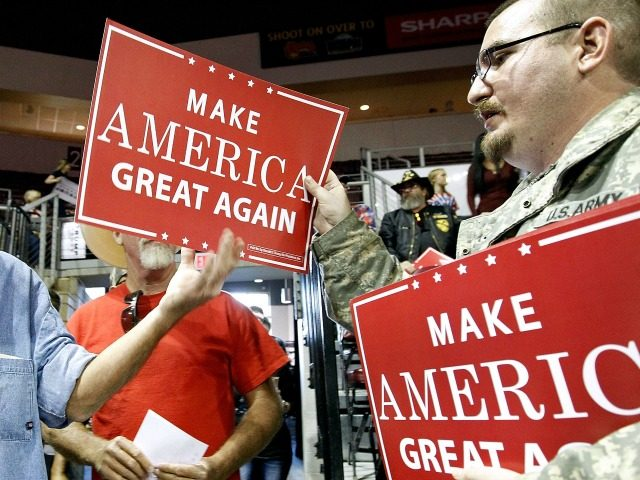 PRESCOTT VALLEY, AZ - OCTOBER 04: Volunteers hand out campaign signs to Trump supporters before Republican presidential nominee Donald Trump speaks at a campaign rally on October 4, 2016 in Prescott Valley, Arizona.