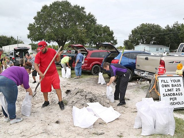 Locals scramble to fill sandbags with the last of a supply at the Road and Bridge Department in Kissimmee, Florida in preparation for the landfall of Hurricane Matthew, on October 6, 2016. Some three million people on the US southeast coast faced an urgent evacuation order Thursday as monstrous Hurricane …