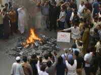 "Pakistani shopkeepers and traders burn Indian products including TV transmission systems and CDs during a demonstration in Lahore on October 8, 2016, in support of Kashmiri Muslims. Tensions have spiked since New Delhi said the previous week that it had launched ""surgical strikes"" on militant posts across the disputed border …"