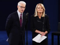 ST LOUIS, MO - OCTOBER 09:  Moderator Anderson Cooper of CNN (L) and moderator Martha Raddatz of ABC speak before the town hall debate at Washington University on October 9, 2016 in St Louis, Missouri. This is the second of three presidential debates scheduled prior to the November 8th election.  (Photo by Chip Somodevilla/Getty Images)